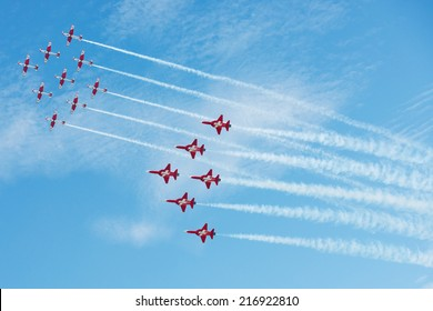 PAYERNE, SWITZERLAND - SEPTEMBER 7: Common flight to celebrate 25th and 50th Anniversary of PC-7 and Patrouille Suisse aerobatic teams on AIR14 airshow in Payerne, Switzerland on September 7, 2014