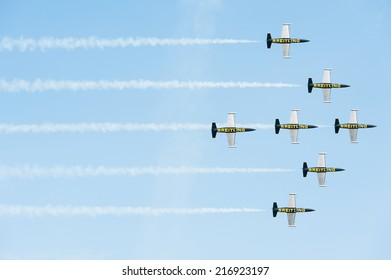 PAYERNE, SWITZERLAND - SEPTEMBER 7: Flight of Breitling Jet Team in close formation on AIR14 airshow in Payerne, Switzerland on September 7, 2014
