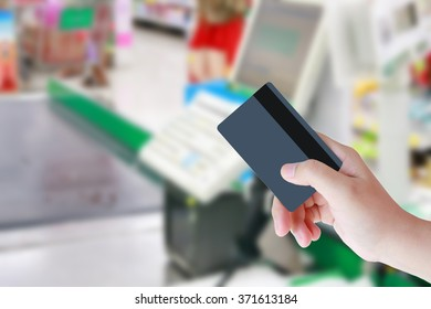 Paying credit card for purchases at the supermarket