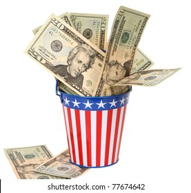 Paying Uncle Sam -- Twenty-dollar bills stuffed into a stars-and-stripes decorated pail. Concept of American money going to the government in taxes.