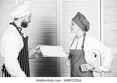 Paying wage. Female bookkeeper with account report paying money wage. Restaurant balance book. Master cook and helper holding account book and cash money. Cook helper giving cooking worksheet to chef.