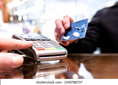 Payment by card, in the payment terminal. Electronic money. Mobile banking. Shopping complex