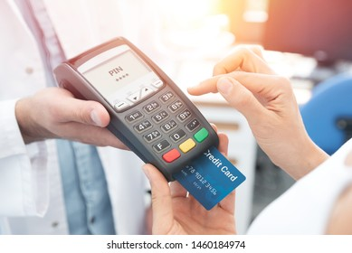 Payment by credit card with terminal. Woman enters the pin code