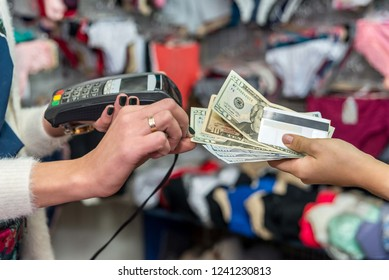 Payment concept in underwear shop with cash and card