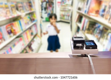 Payment counter, blur image of children sitting reading books in bookstores.
