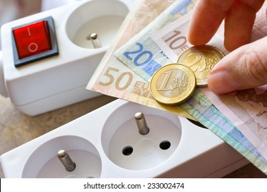 payment for electricity in model family house - energy supply and power outlet with euro money