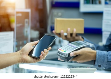 Payment with smartphone, Internet banking and technology concept