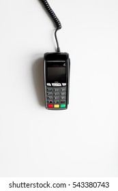 payment terminal with card on white background top view
