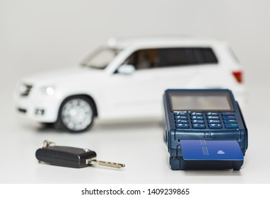 Payment terminal and card. Payment for the purchase of a car is a cashless settlement. The key to the car.