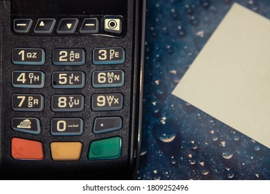 Payment terminal on the table with a sheet of paper