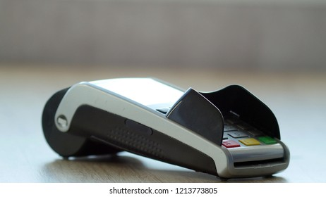 Payment terminal for paying with credit card close-up