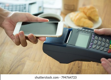 Payment transaction Customer paying shopping transfer smartphone app Mobile Payment with NFC technology on phone store