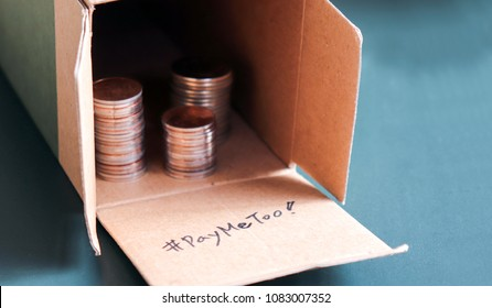 #PayMeToo as a new campaign to close the wage gap between men and women. An open pile of paper boxes and coins.