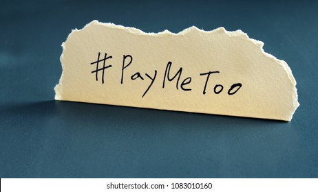 #PayMeToo as a new campaign to close the wage gap between men and women. Handwrittenletter#PayMeTooonyellowpaper.