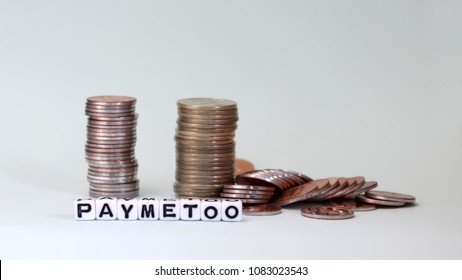 #PayMeToo as a new campaign to close the wage gap between men and women. White cube as #PayMeToo and coins.