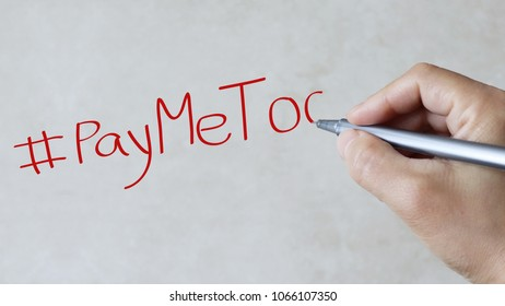 #PayMeToo text on paper background.