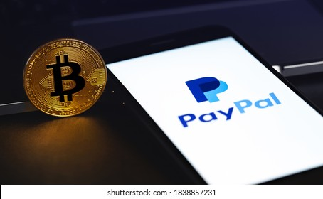 PayPal logo on the screen smartphone with bitcoin cryptocurrency in the dark. Paypal is an internet based digital money transfer service. Moscow, Russia - October 20, 2020