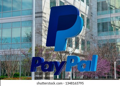 PayPal logo and sign in front of PayPal Holdings headquarters building in North San Jose Innovation District in Silicon Valley - San Jose, California, USA - March 17, 2019