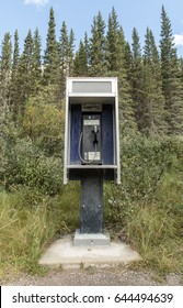 A payphone in the remote wilderness of Kananaskis country.