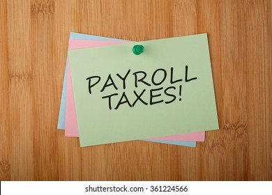 Payroll Taxes! written on green paper note