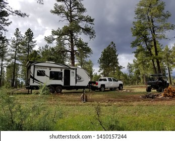 Payson, AZ/USA - May 15, 2019:  Camper set up in the forest during the spring.