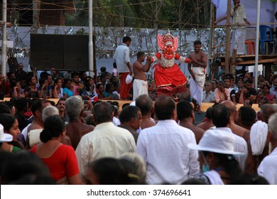PAYYANNUR - FEB 07: A Theyyam artist performs at Thrikaripur Muchilot Bhagavati temple on February 07, 2016 in Payyannur, India.Theyyam is a ritualistic traditional art form of Kerala.