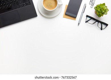 PC With Coffee Cup, Eyeglasses And Smartphone On White Desk