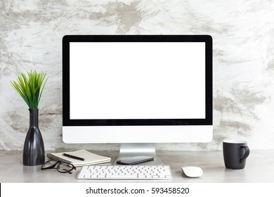 pc computer on workspace table showing blank white screen