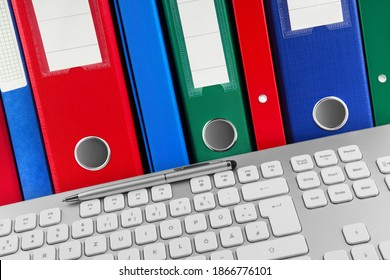 PC keyboard and file folders