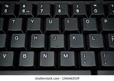 PC keyboard. Spanish. Keyboard background. Black keys QWERTY. PC keyboard