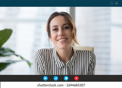 Pc screen view, head shot portrait businesswoman makes videocall looks at webcam consult client distantly, confident business lady lead job interview communicates with applicant by video telephony app