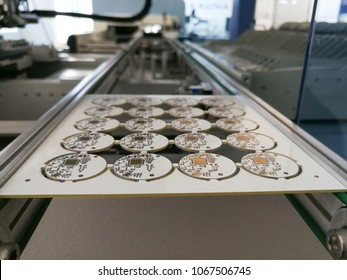 PCB assembly first stages. PCB on the rails of production line inside pick and place machine