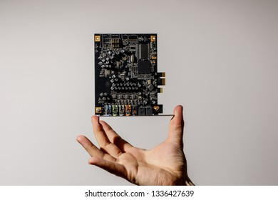 PCI Express card for computer in hand, 7.1 audio chip