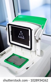 The PCR machine through the use. PCR Thermal Cycler. Lab equipment.
