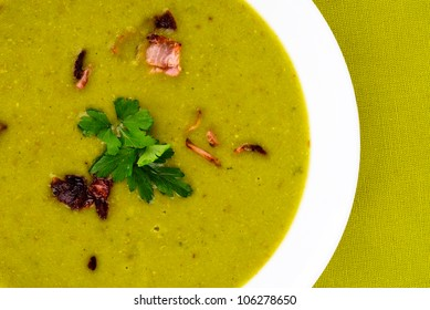 Pea soup with small pieces of bacon.