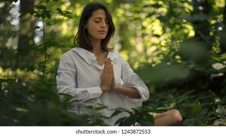 Peace begins with me. Brunette women in yoga position at nature.  Spring season.