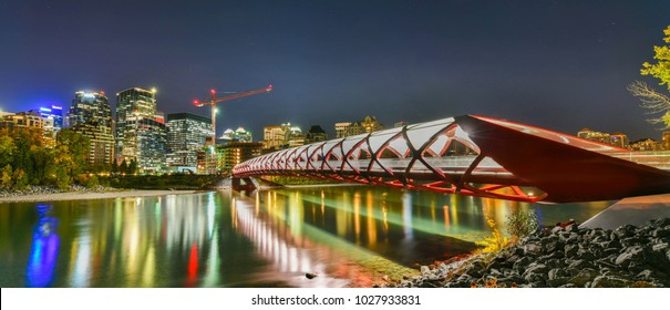 Peace Bridge with Bow River and part of the Calgary downtown in Alberta Canada at night