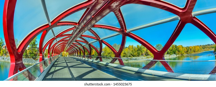 Peace Bridge with Bow River and part of the Calgary downtown in a sunny autumn day.