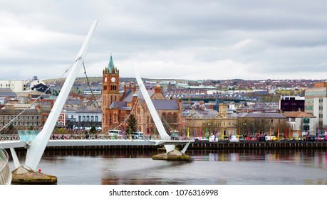 The Peace Bridge over the river Foyle and Guildhall, Derry/Londonderry, Northern Ireland