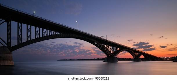 Peace Bridge at Sunset, Buffalo, NY. An international border crossing connecting United States and Canada.