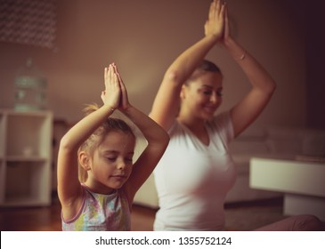 Peace and calm. Mother and daughter working yoga.
