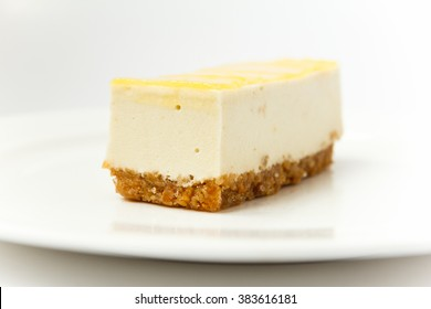Peace of cheese cake on white plate