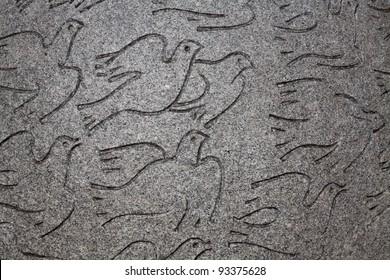 Peace dove representation in a low relief