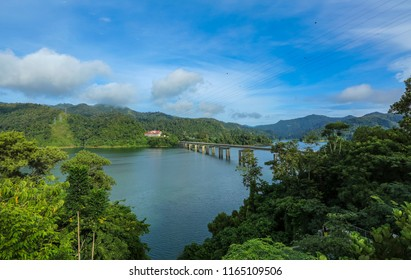 The peace environment and rainforest landscape of Royal Belum State Park reflected off the calm waters of Temengor Lake at Pulau Banding, Perak.