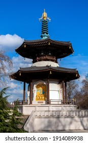 The Peace Pagoda in Battersea Park London England with gilded bronze gold Buddha statues which is a popular travel destination tourist attraction landmark of the city, stock photo image