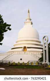 Peace pagoda tower in tropical palms sri lanka