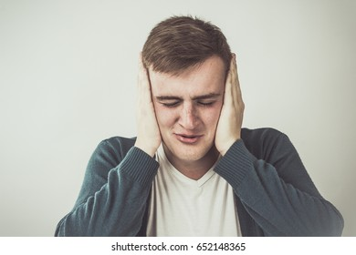 Peace and Quiet Concept - Attractive Man Closed His Ears With Two Hands
