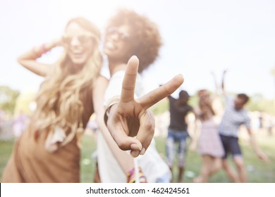 Peace sign made by african descent woman