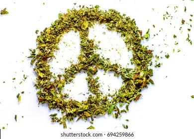 Peace Sign Made of Marijuana. A peace sign symbol made with real marijuana on white. be happy with cannabis. peace symbol mady by cannabis dry green leaves.