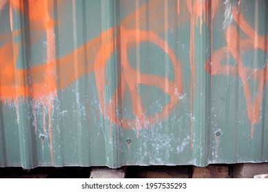 A peace sign painted in graffiti
